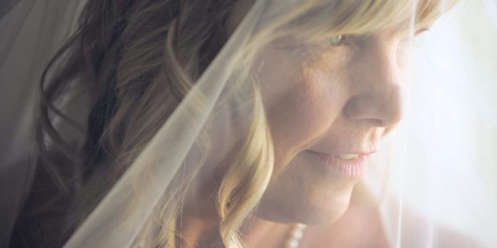 Close up mature bride with vale