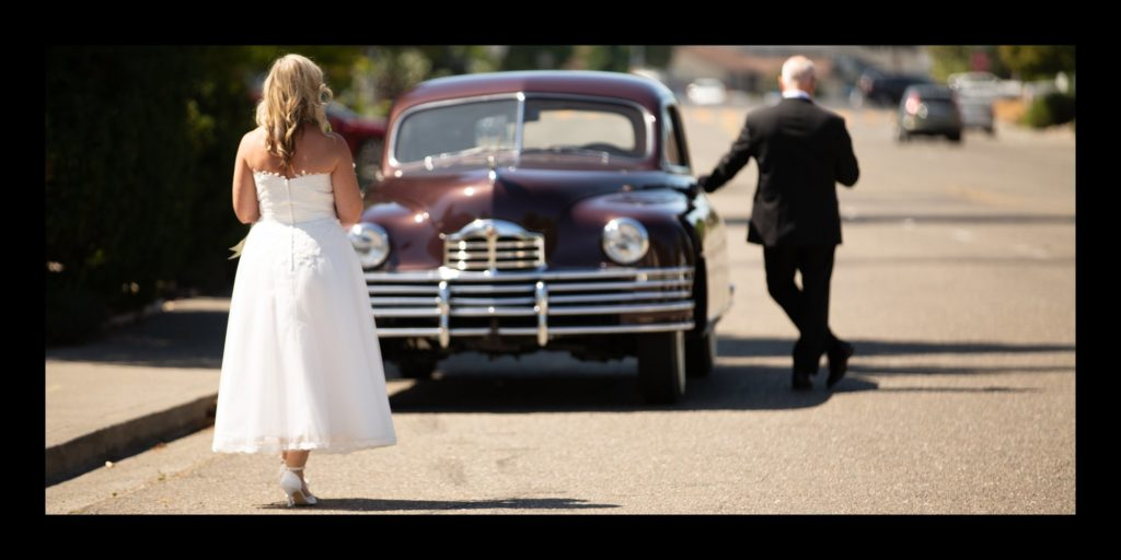 Bride and groom first look with old car