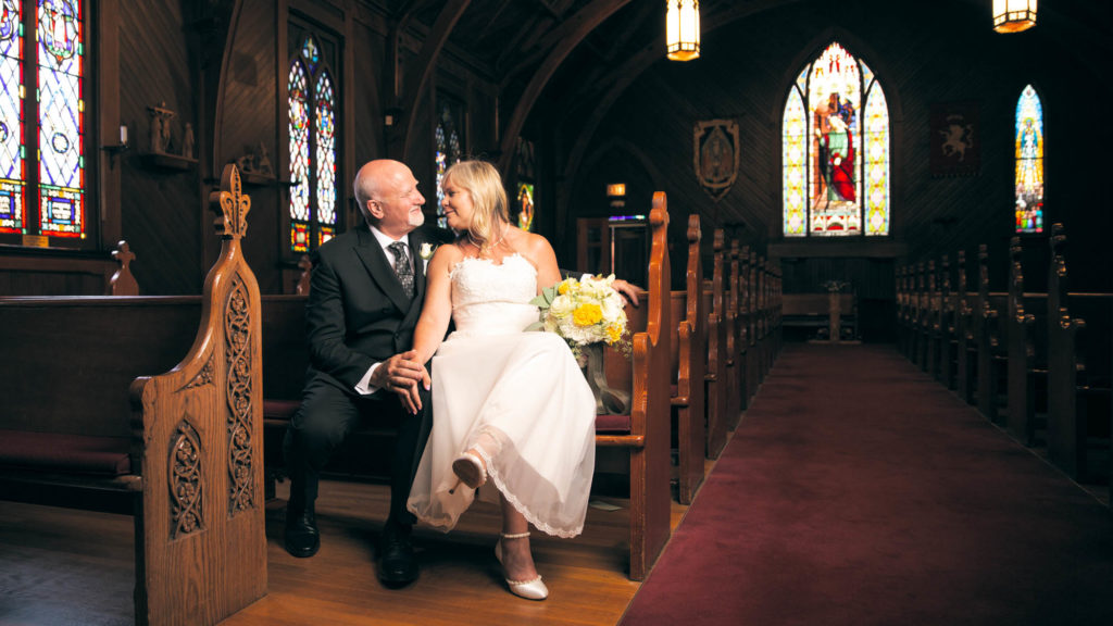 Wedding portrait of man and woman in church.