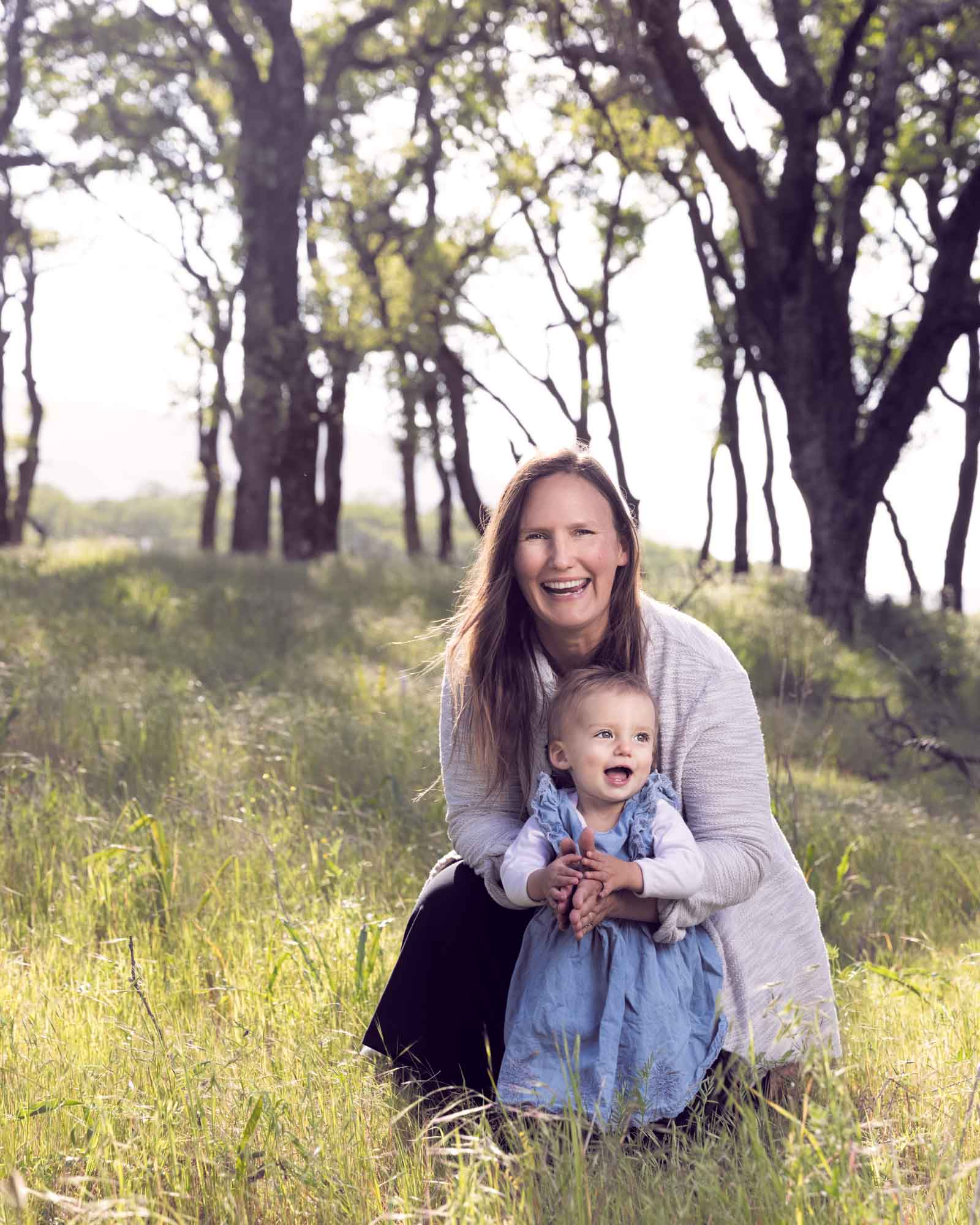 Children's portraits of a mom with her toddler baby girl in a bay area oak forest