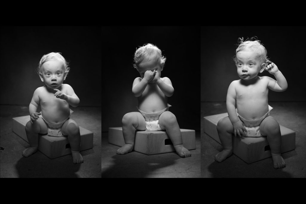 3 black and white children's portraits of a toddler boy sitting on an apple box