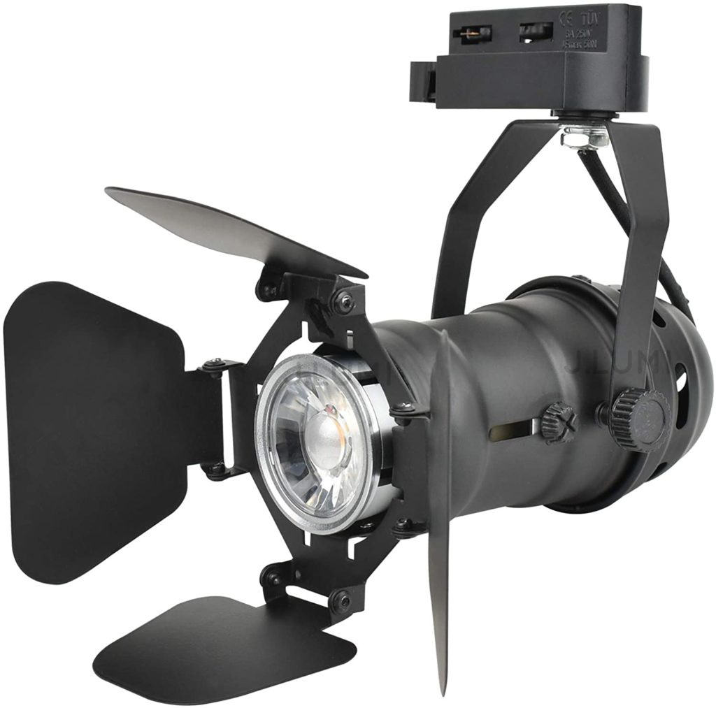 Fully adjustable track light for lighting pictures on the wall