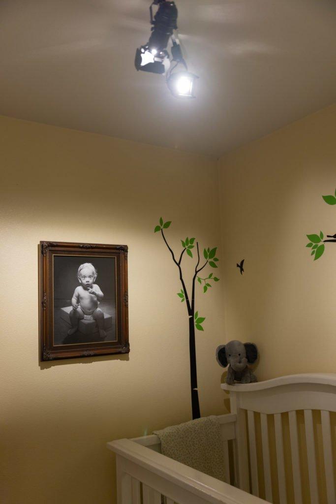 portrait of a baby on wall illumated by J.Lumi LED Light