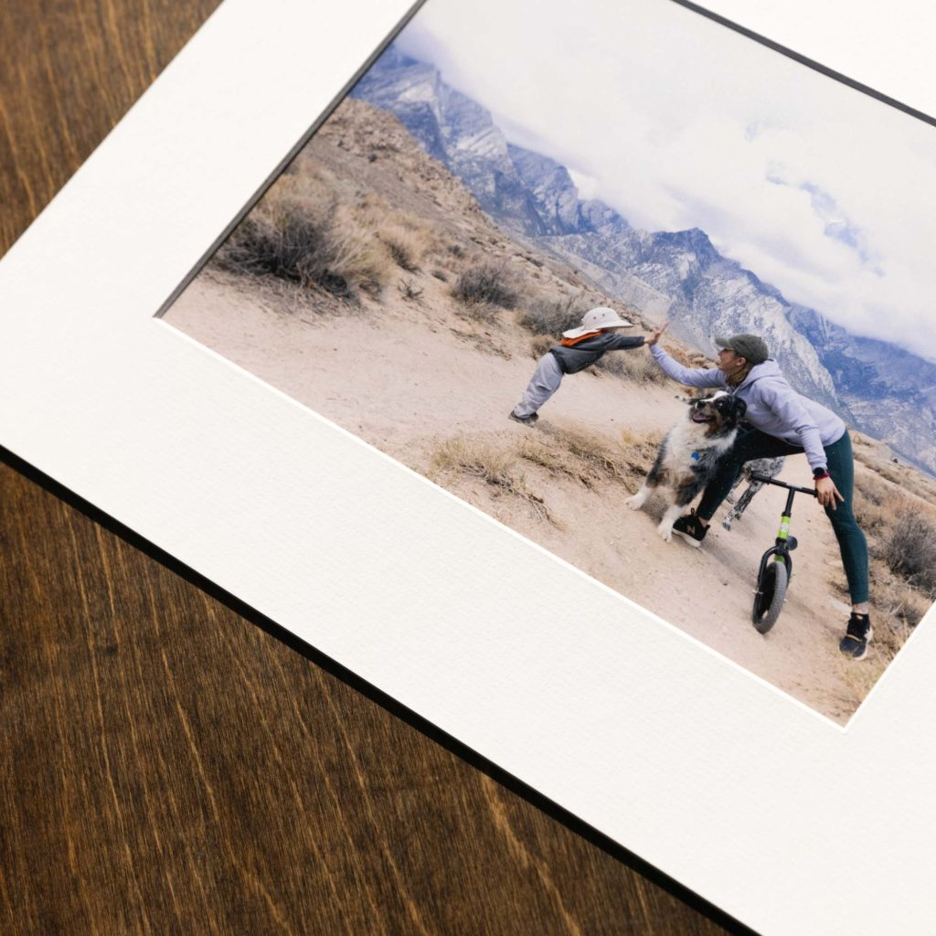 luster print of a little kid learning to ride his bike in an epic landscape
