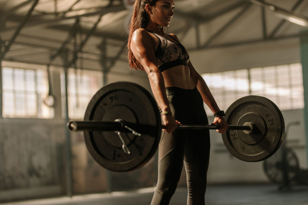 Woman Losing Weight For Wedding by doing heavy deadlifts